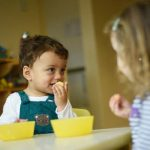 child exploring new tastes and texture at nursery